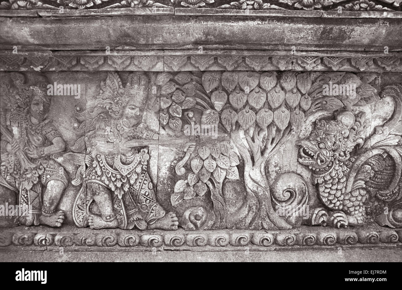 Singaraja temple, King accompanied with his attendant- killing a syncretic animal in the forest. Bali Indonesia - Stock Image