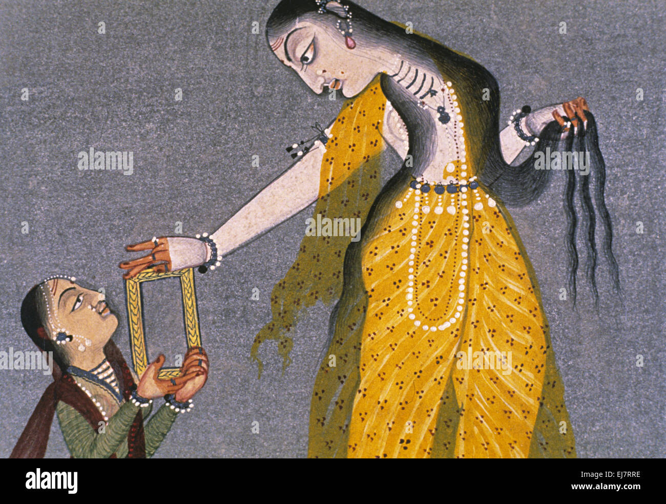 Toilet scene.-Lady with attendant. Rajput miniature painting circa 17th. Century A.D. India - Stock Image