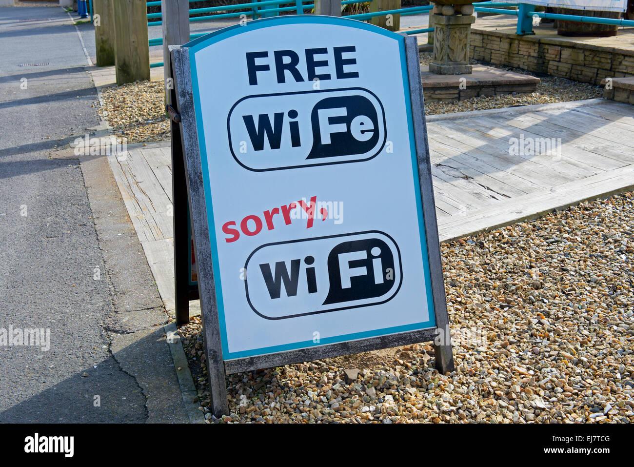 Sign - free wi-fe, sorry wi-fi - outside pub, England - Stock Image