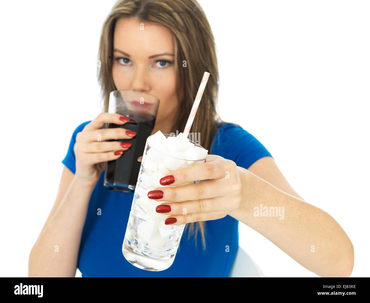 Attractive Young Woman Drinking High Sugar Fizzy Drink - Stock Image