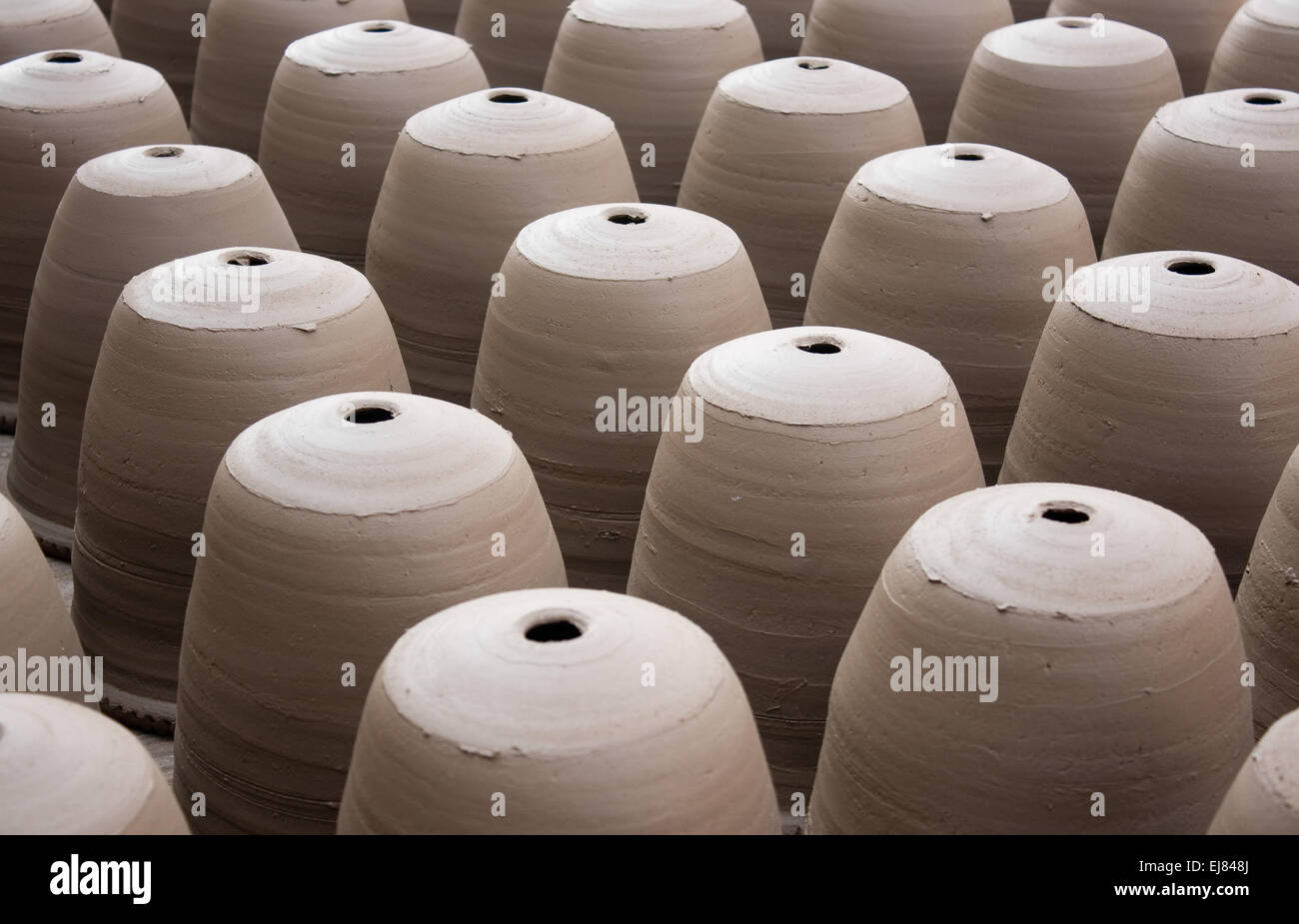 A view of fresh hand made earthen potts made by potter. - Stock Image