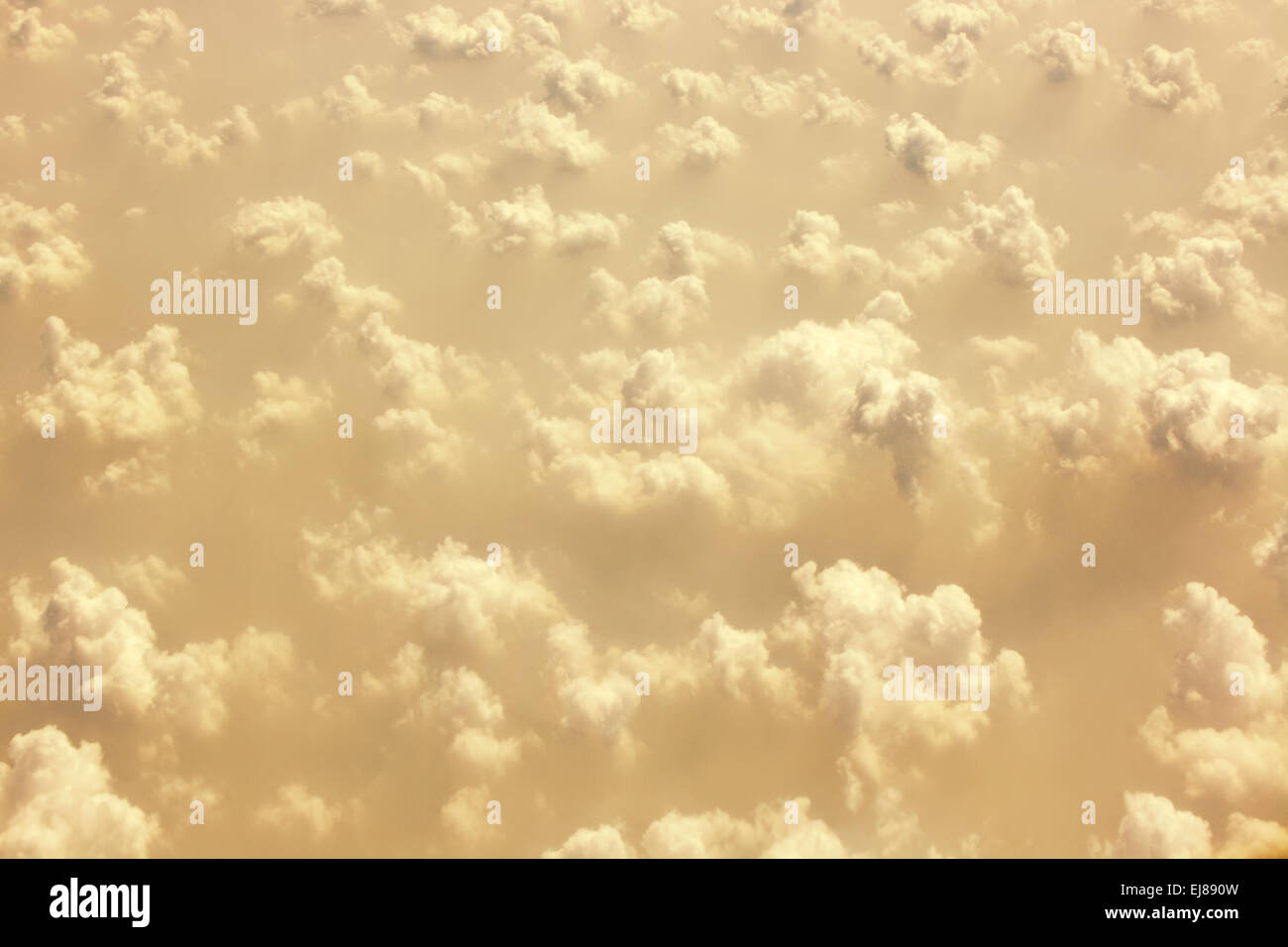 Aerial skyscape showing interesting  clouds in golden light. - Stock Image