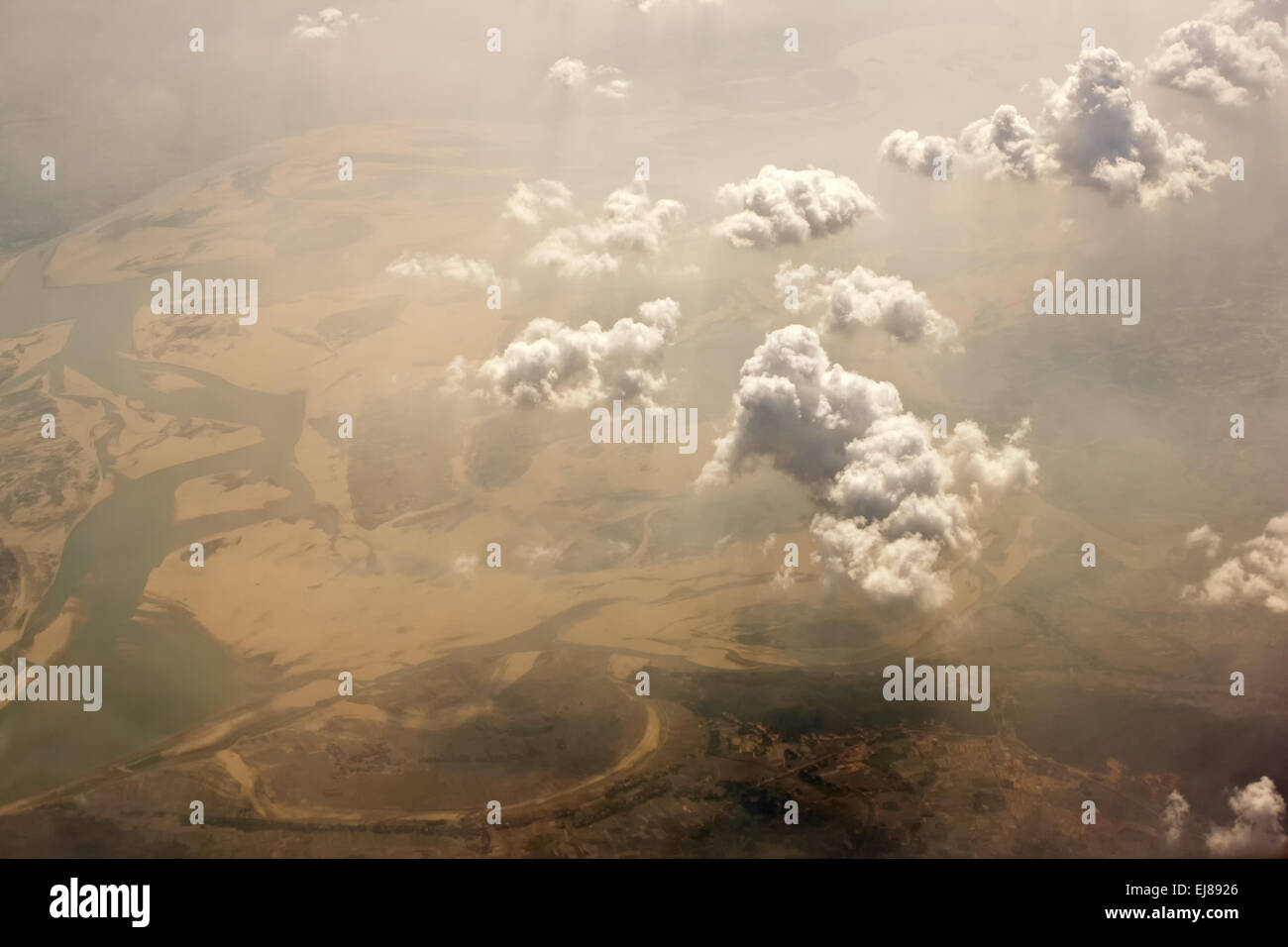 Aerial skyscape showing interesting  clouds & land in golden light. - Stock Image