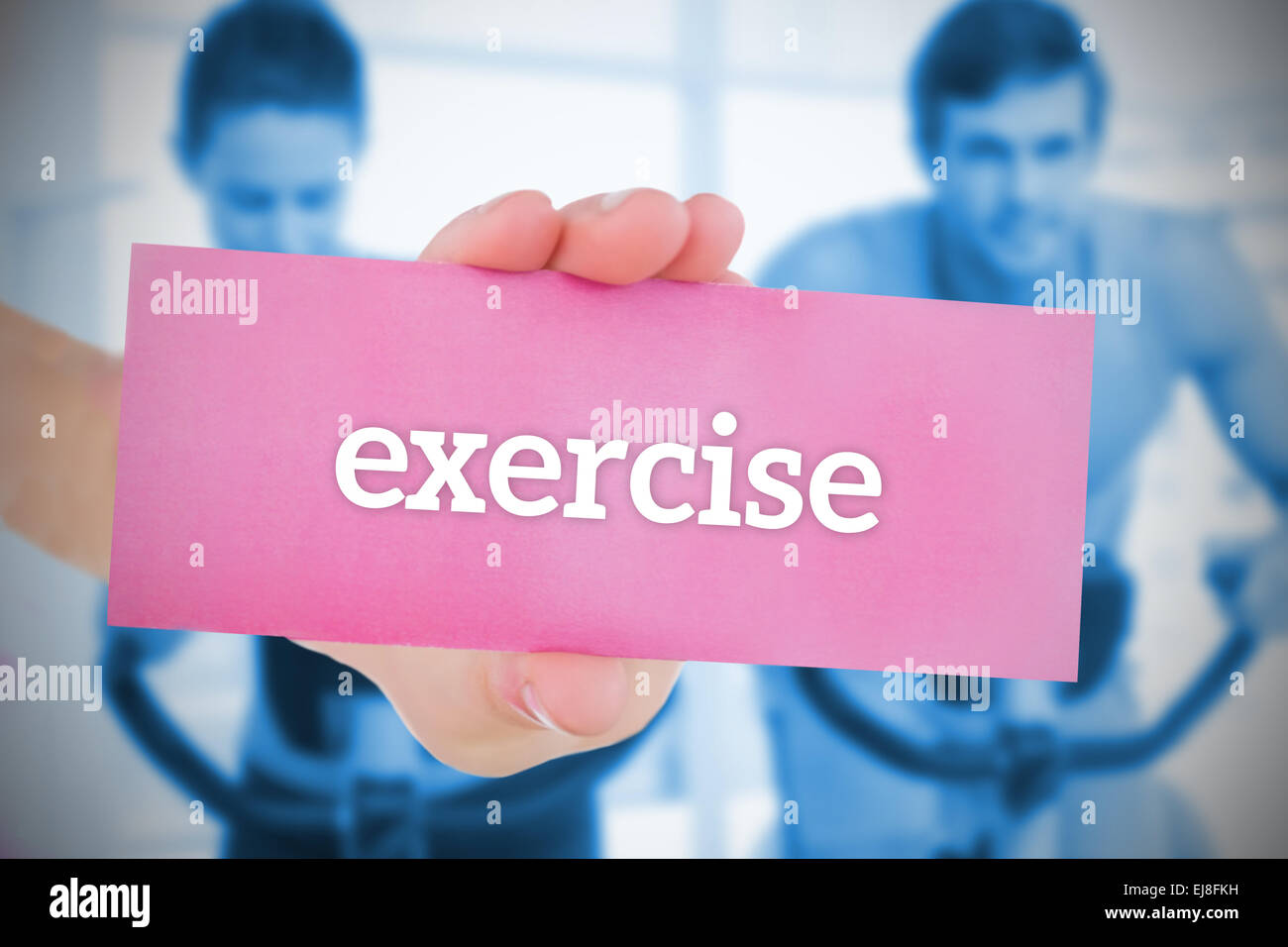 Woman holding pink card saying exercise - Stock Image