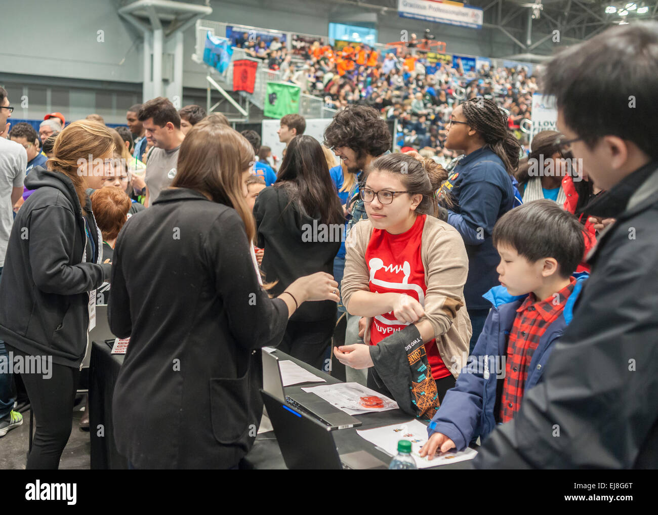 Participants visit the Google booth at a Career Expo held at the FIRST Robotics NYC Championship at the Jacob Javits - Stock Image