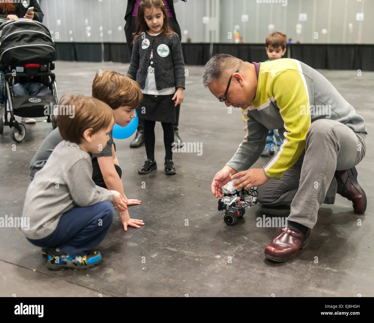 A member of the I LUG NY (Lego Users Group) explains a robot at a Career Expo held at the FIRST Robotics NYC Championship - Stock Image