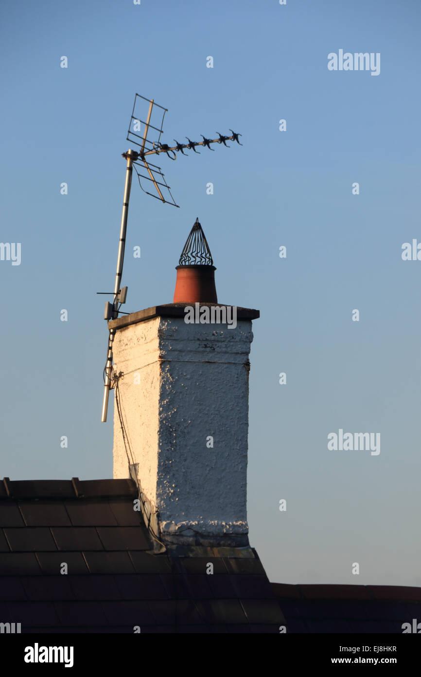 Single UK television aerial on old chimney - Stock Image