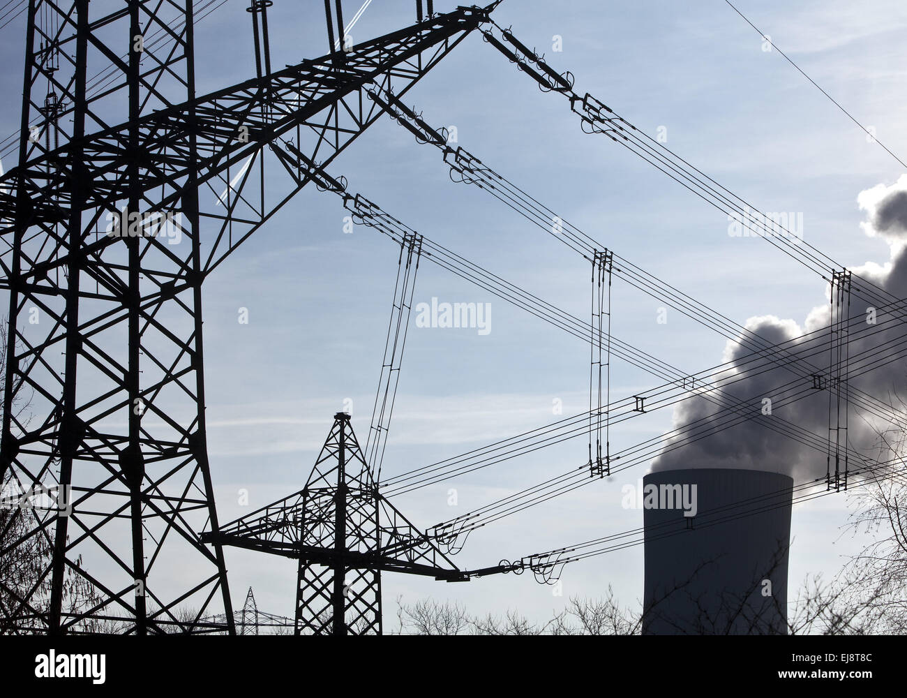 High voltage power pylons with industry - Stock Image