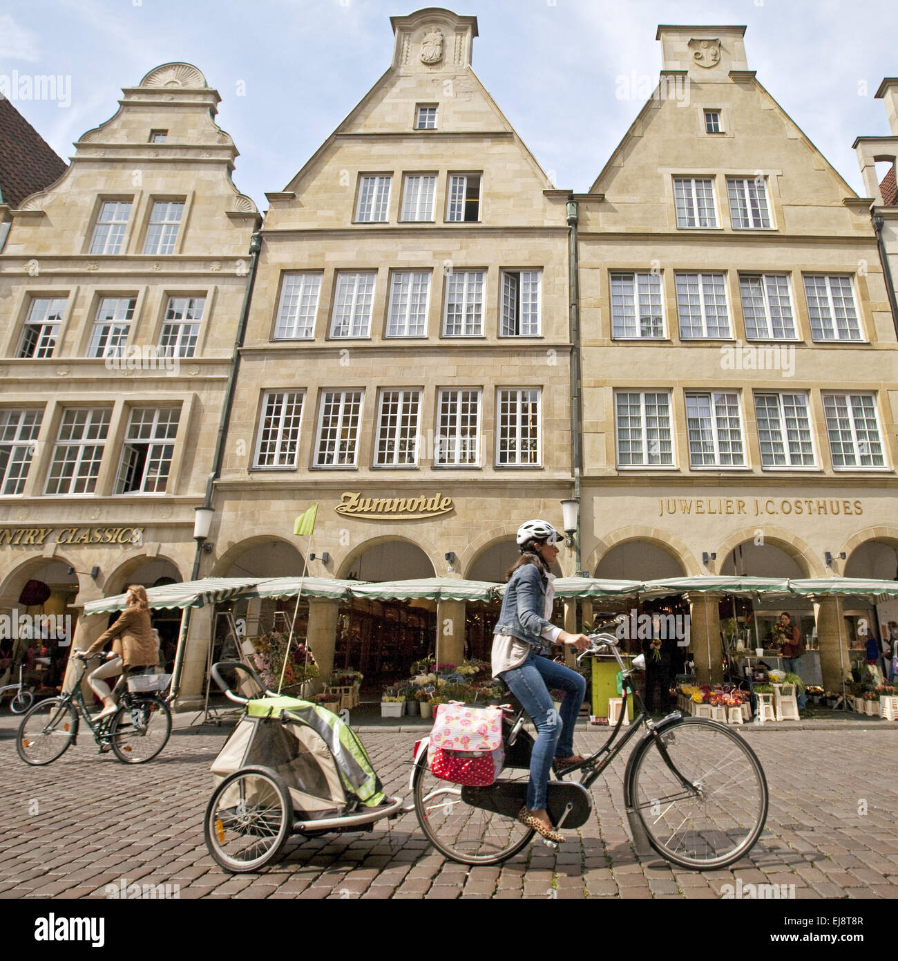 Two bicycle riders, Muenster, Germany - Stock Image