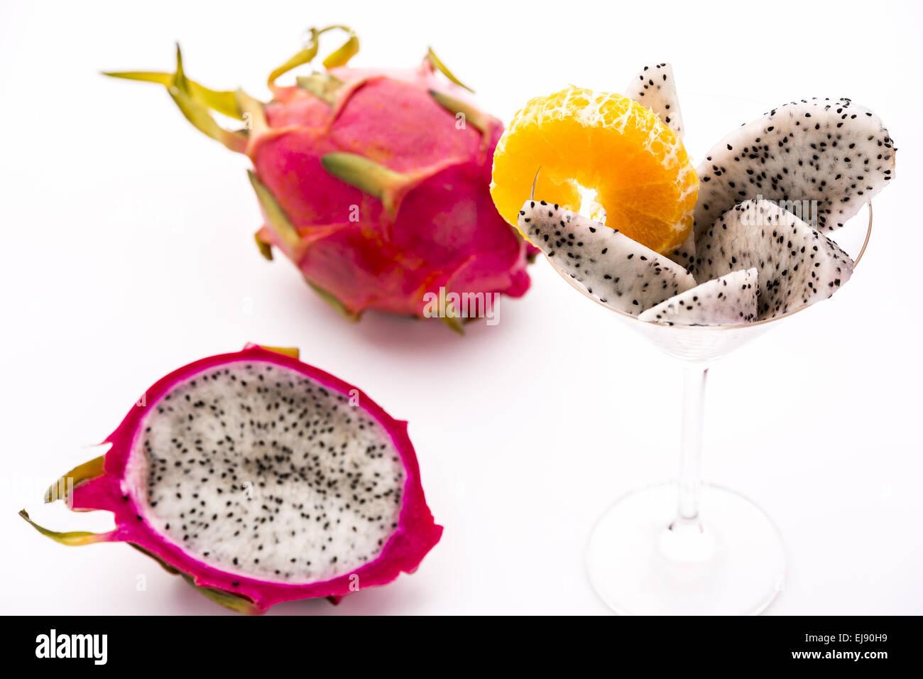 Vibrant purple fruit with white pulp: Pitaya - Stock Image