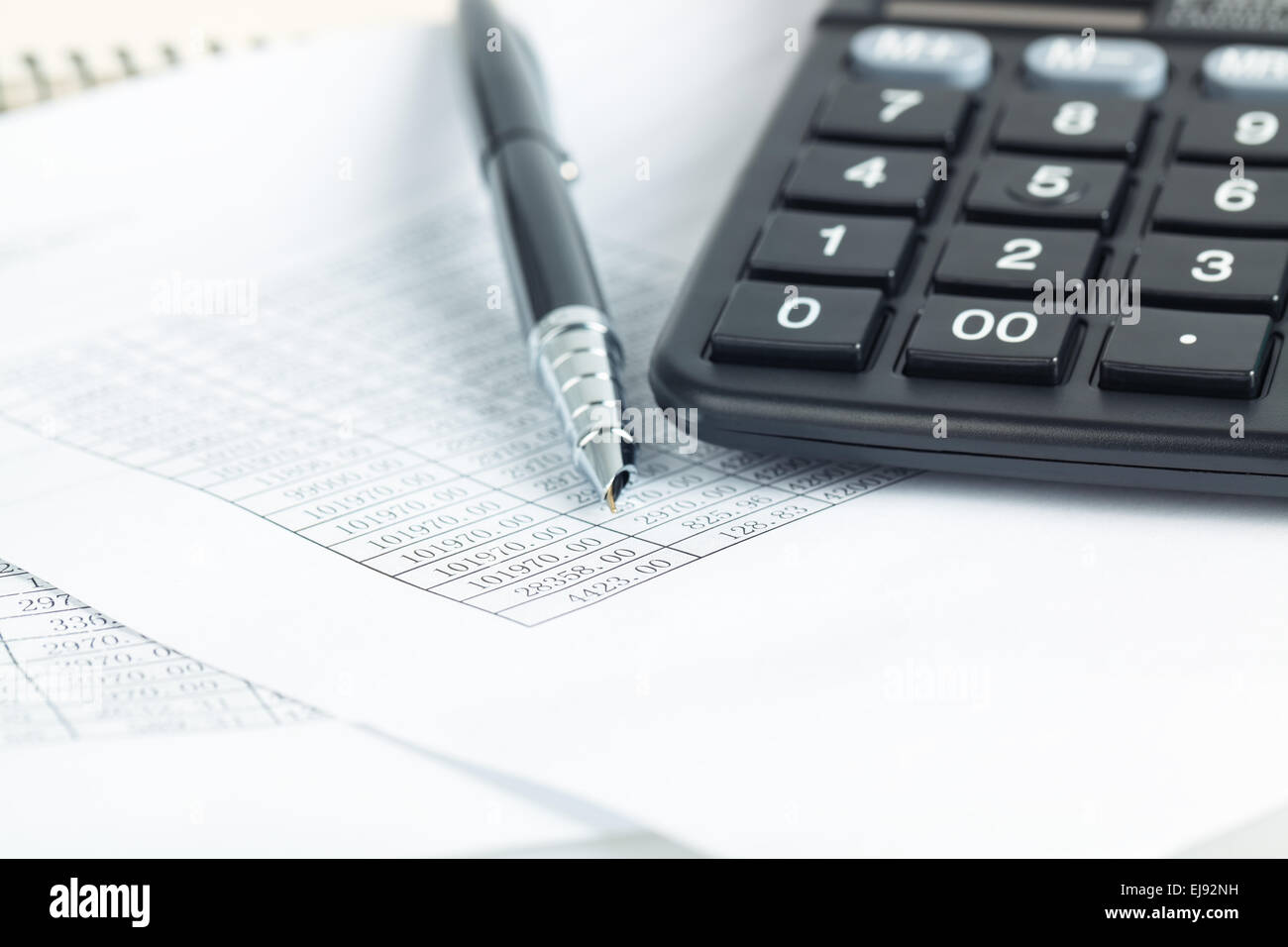 calculator and pen with financial documents - Stock Image