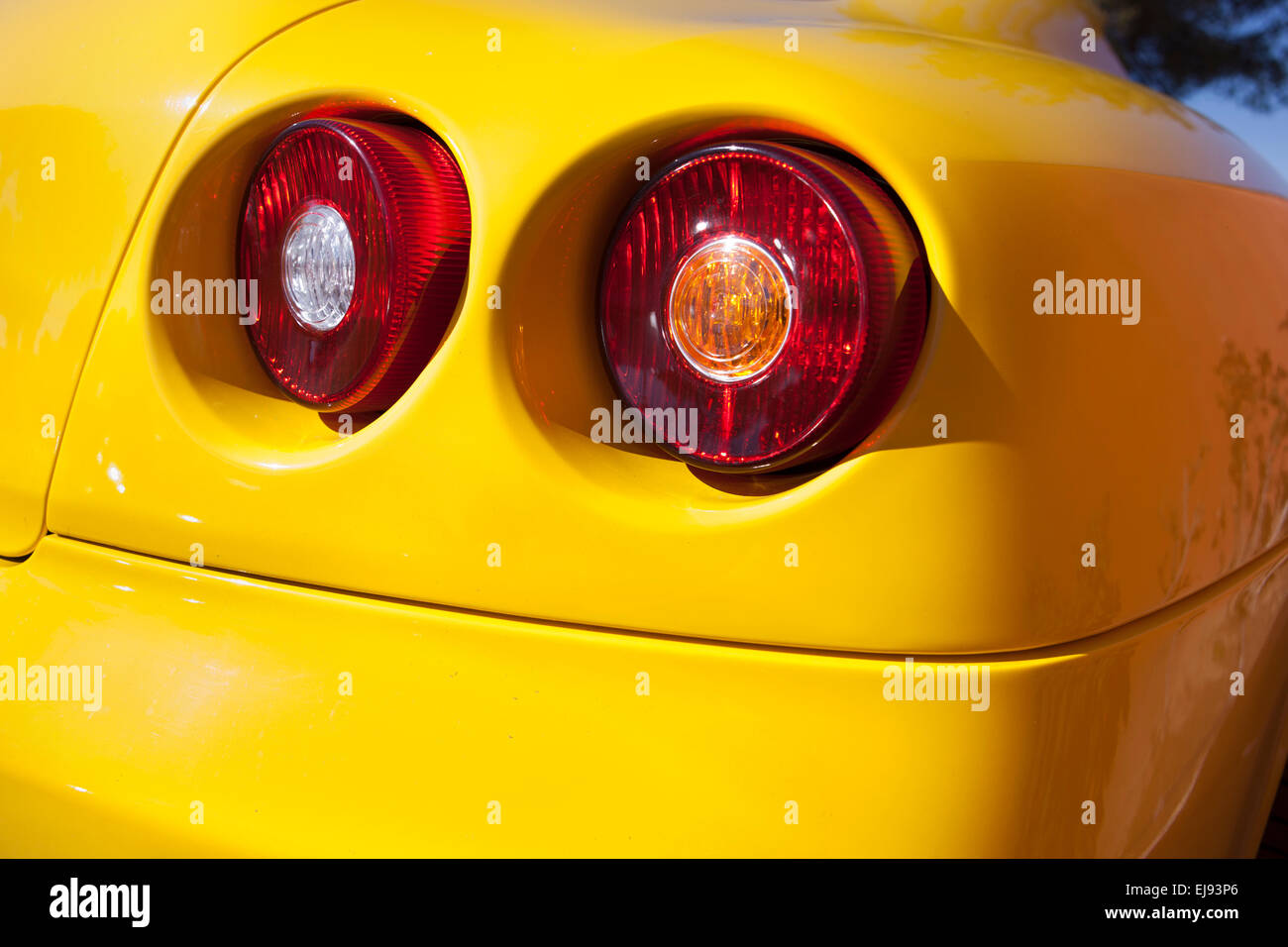 Yellow sports car spot lights. Detail of a luxury car - Stock Image