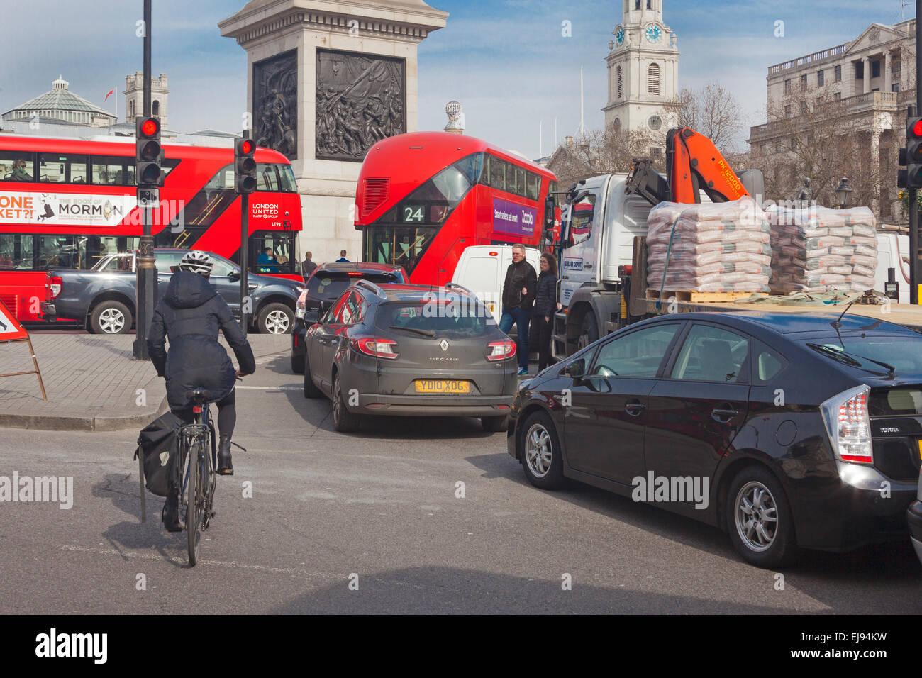 London, Trafalgar Square   Late morning traffic congestion approaching gridlock - Stock Image