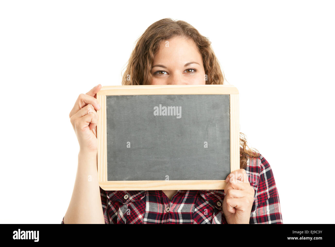 Young woman holding an empty slate Stock Photo