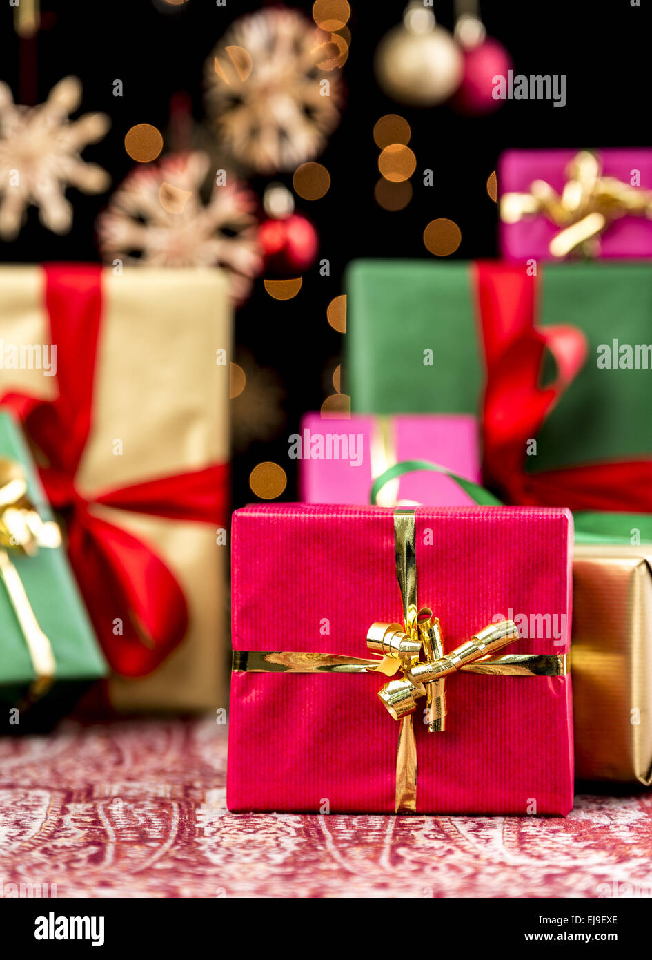 Christmas Background with Gifts and Glitters Stock Photo
