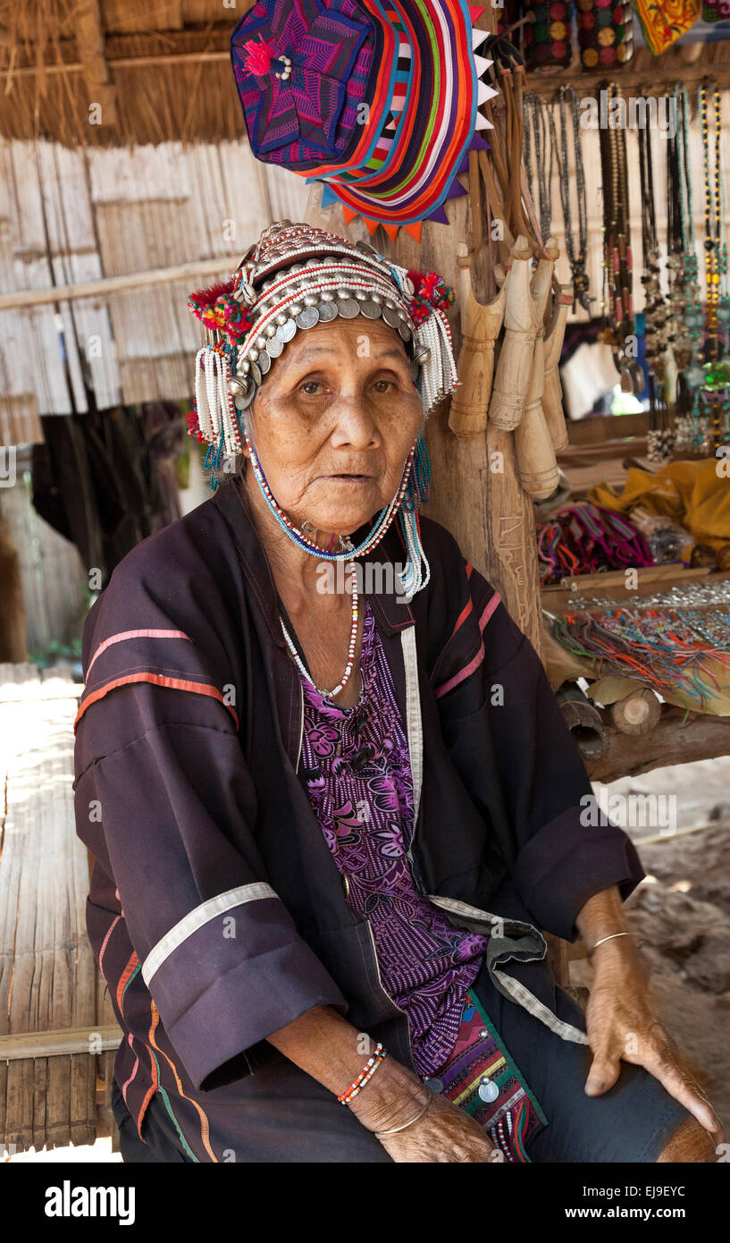 Older Akha woman, Northern Thailand, selling craft work - Stock Image