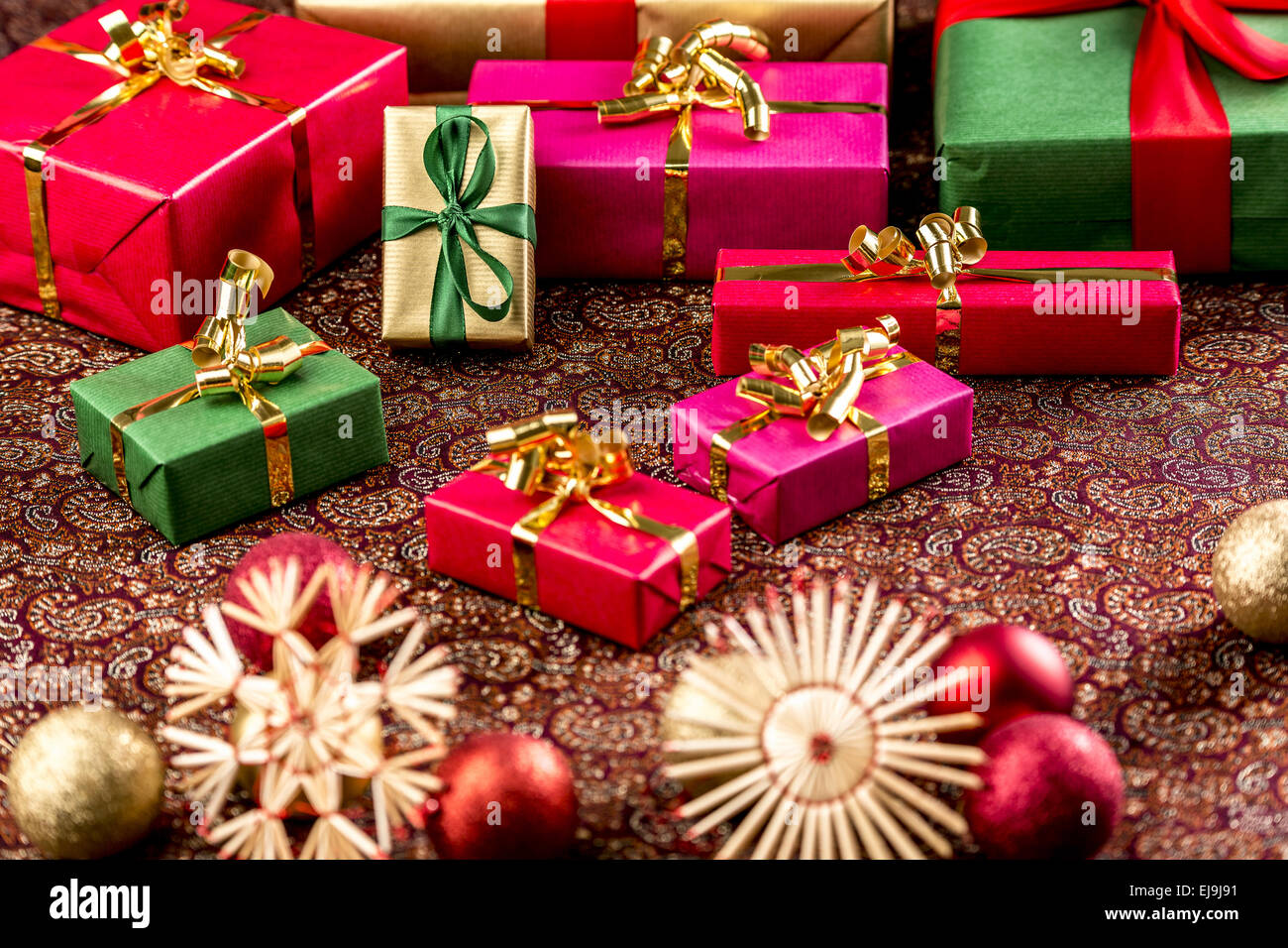 Christmas Gifts on Richly Textured Cloth - Stock Image