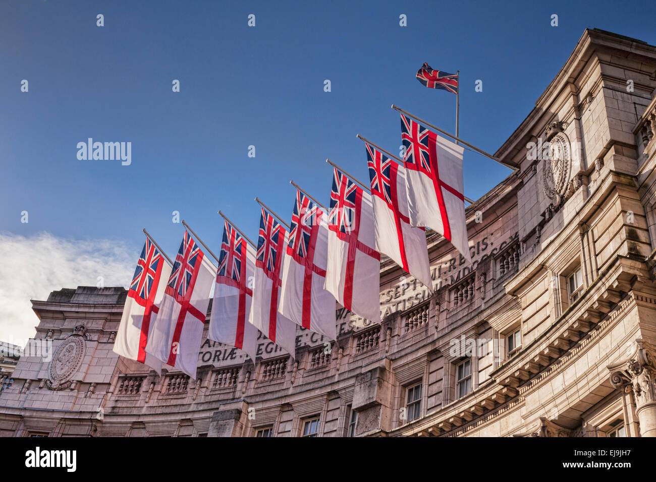 Admiralty Arch flying White Ensigns, the flag of the Royal Navy. - Stock Image