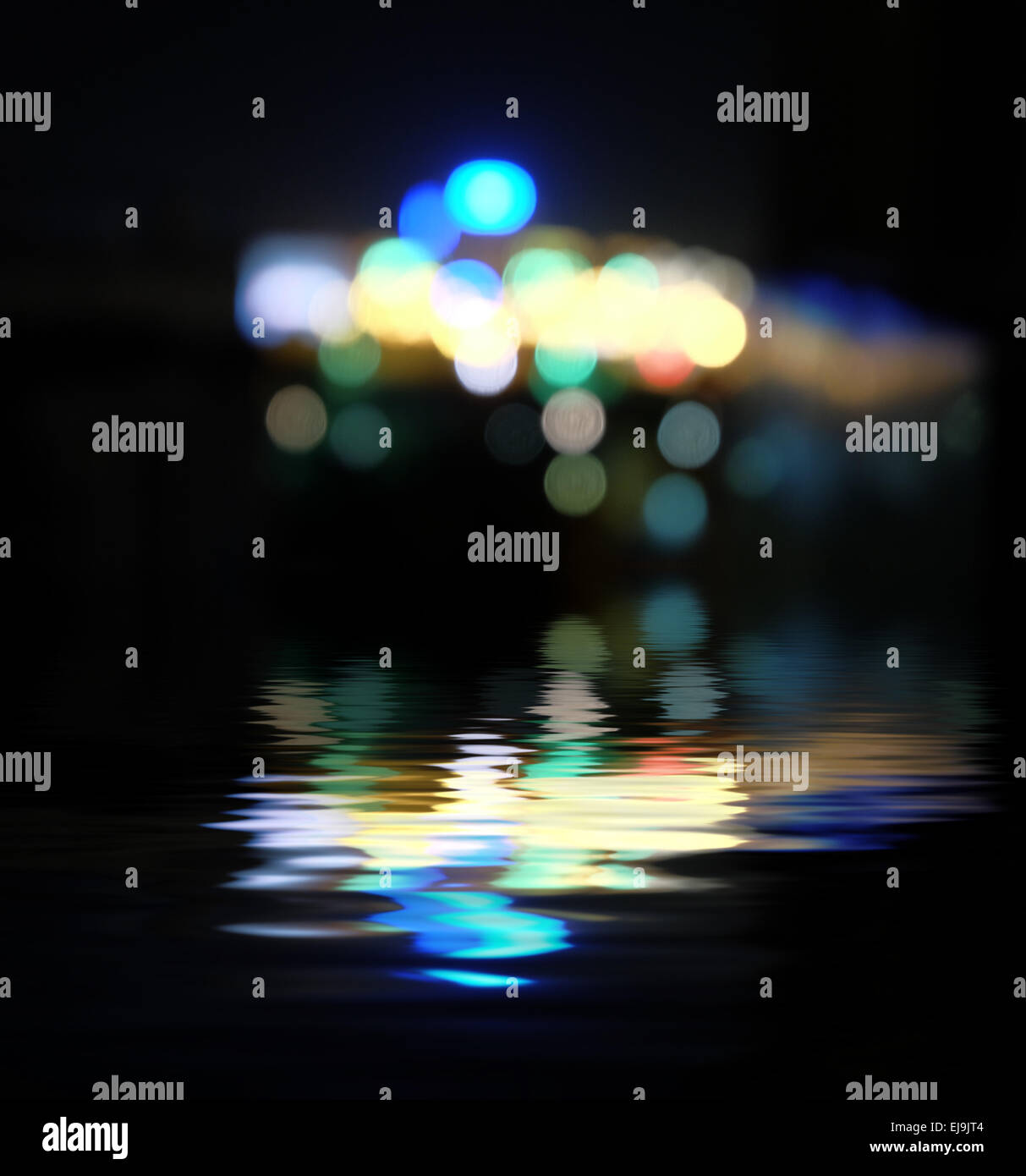 Blurred city at night, bokeh background. - Stock Image