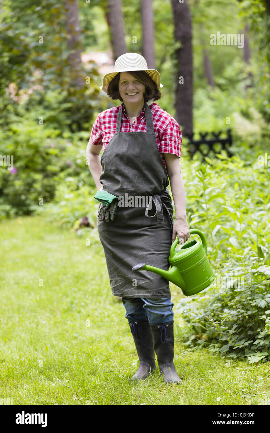 gardener with watering can - Stock Image
