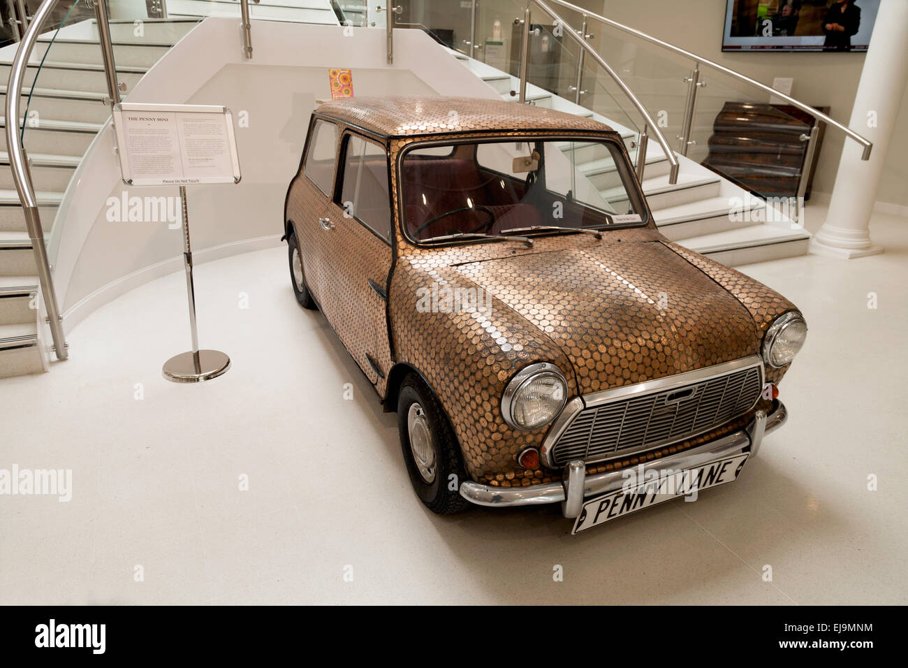 """ Penny Mini "" car, covered with old pennies, possibly linked to the Beatles song "" Penny Lane"",  for sale at auction, Stock Photo"