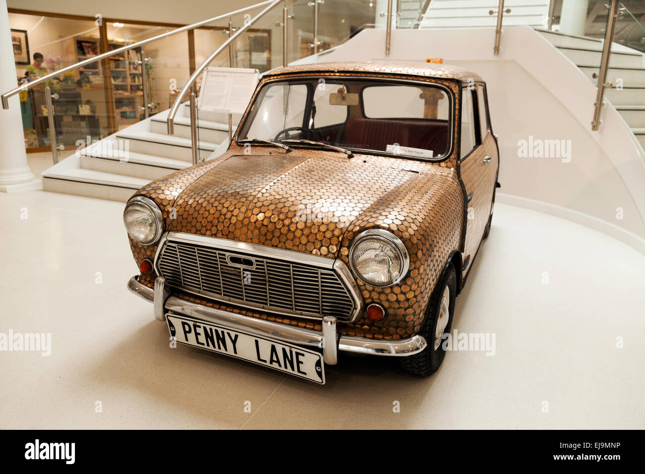 ' Penny Mini ' car, covered with old pennies, possibly linked to the Beatles song ' Penny Lane', - Stock Image
