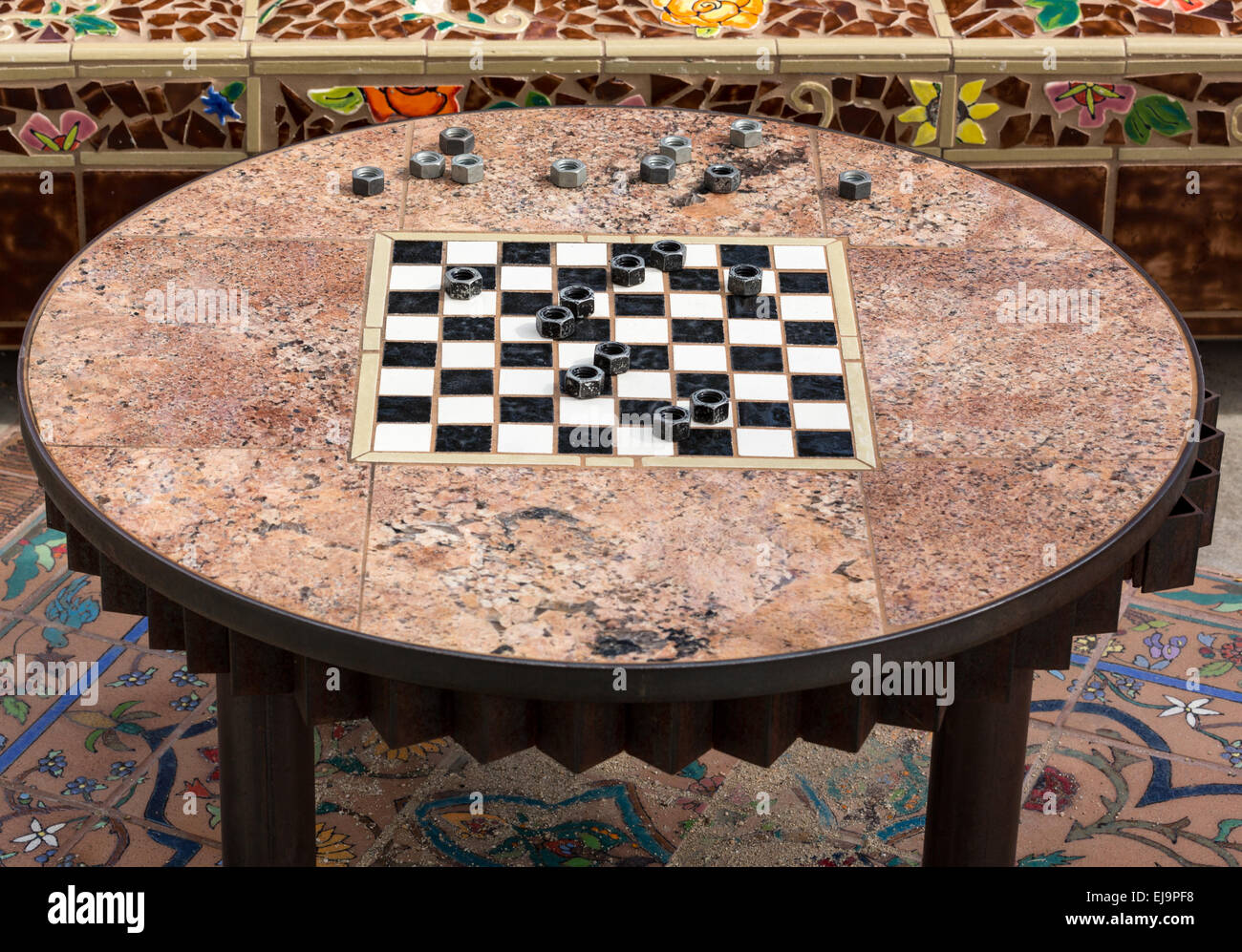 Checkers or Draughts game with metal nuts - Stock Image
