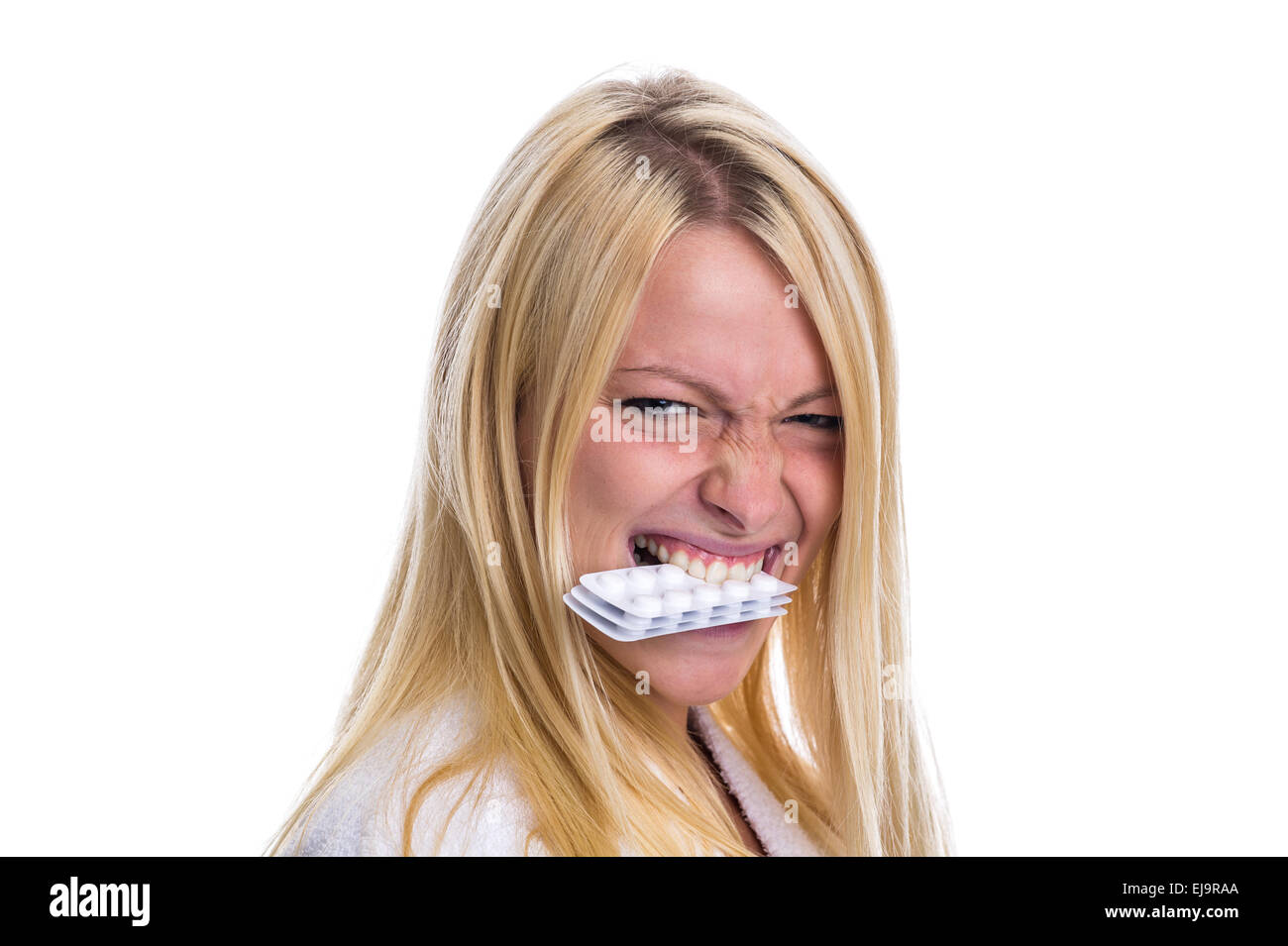 Woman with pills in her mouth Stock Photo