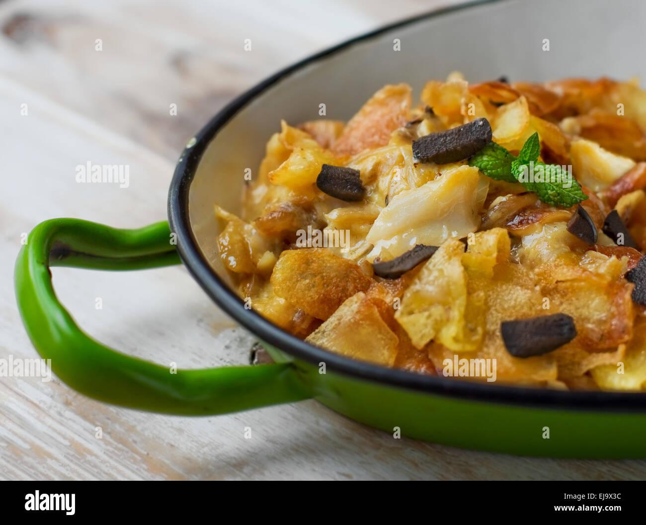 Cod Bras style (Bacalhau a Bras). Portuguese cuisine. - Stock Image