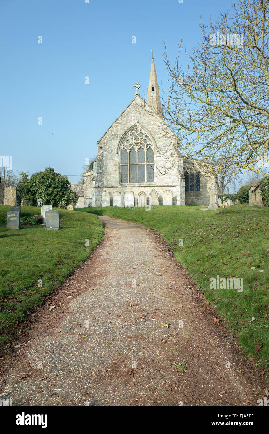 Path to the medieval village church  and cemetery at the english village of Grafton Underwood (mentioned in the - Stock Image
