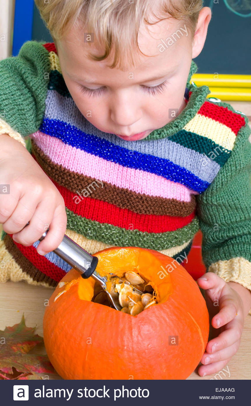 Little boy emptied pumpkin Stock Photo