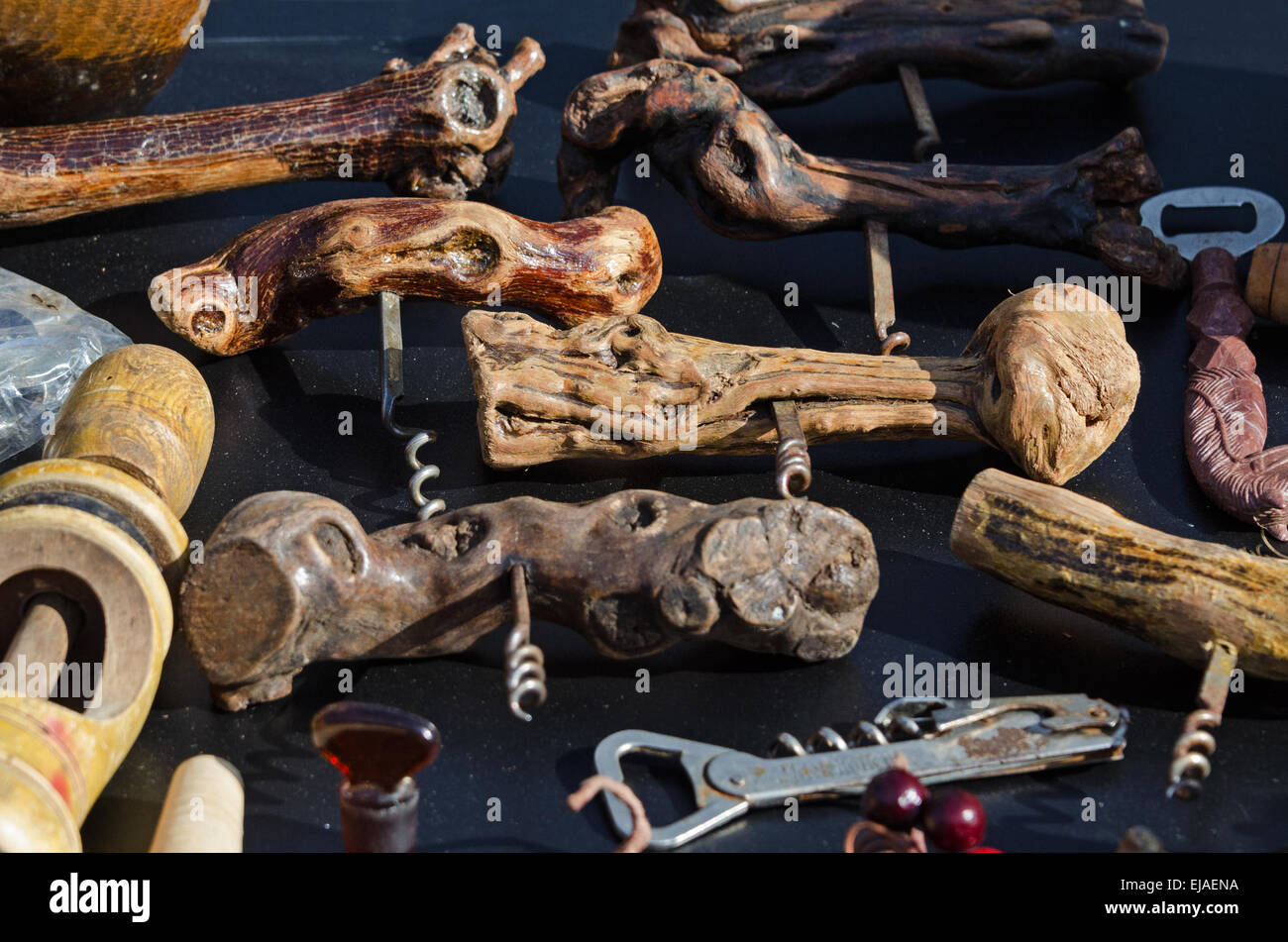 Corkscrews made from the roots of wine grapevines at the August flea market in Gigny-sûr-Saône, Burgundy, - Stock Image
