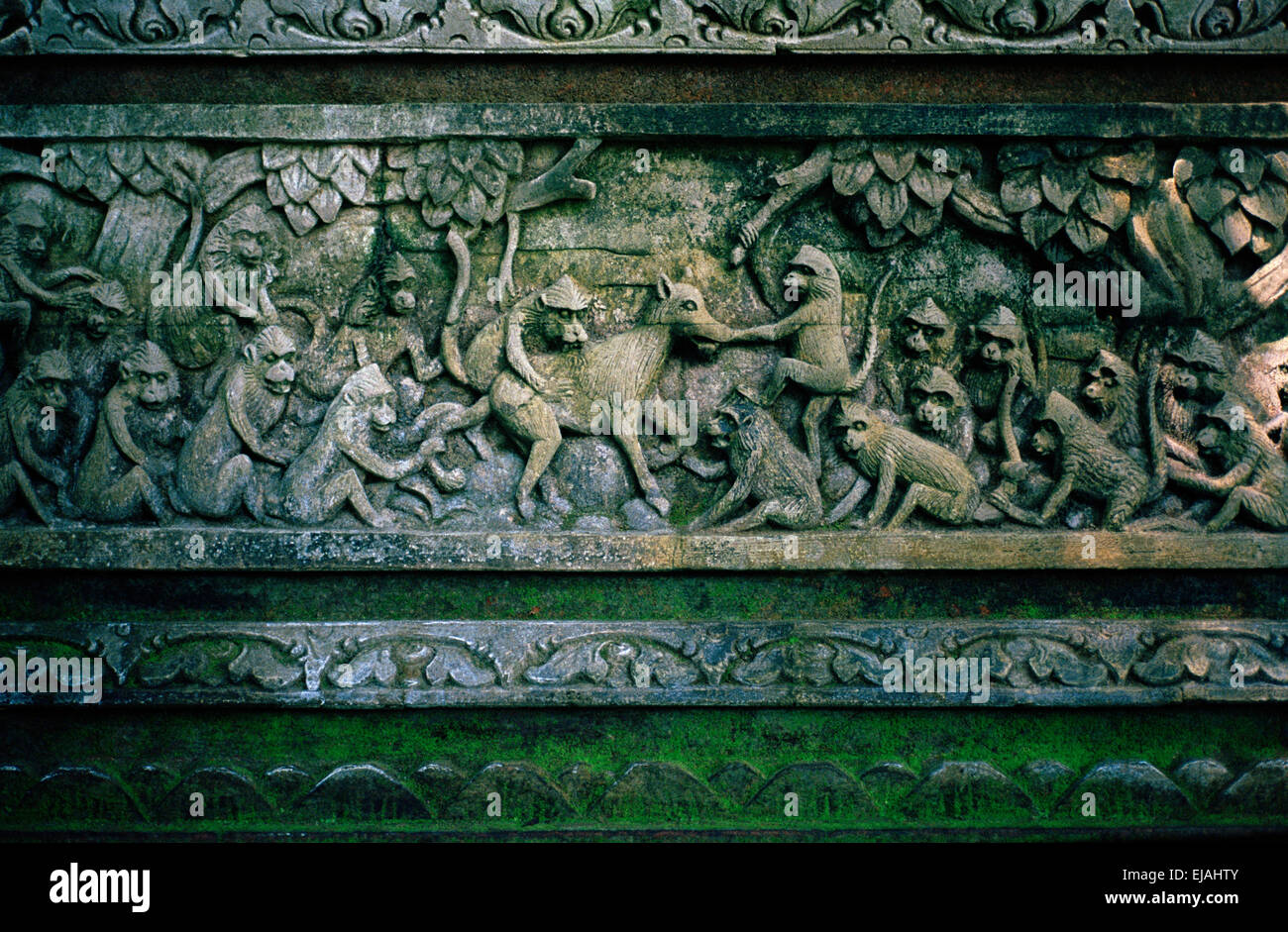 In the Monkey Forest in Ubud in Bali in Indonesia in Southeast Asia. Sculpture Carving Art Temple Religious History - Stock Image