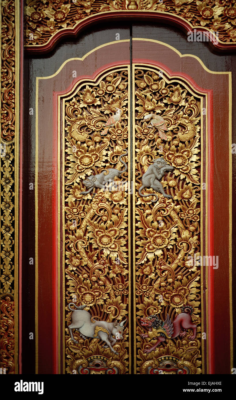 Ornate decorative door of a Hindu temple in Ubud in Bali in Indonesia in Southeast Asia. Religion Religious Art Culture Balinese Wanderlust Travel & Ornate decorative door of a Hindu temple in Ubud in Bali in ...