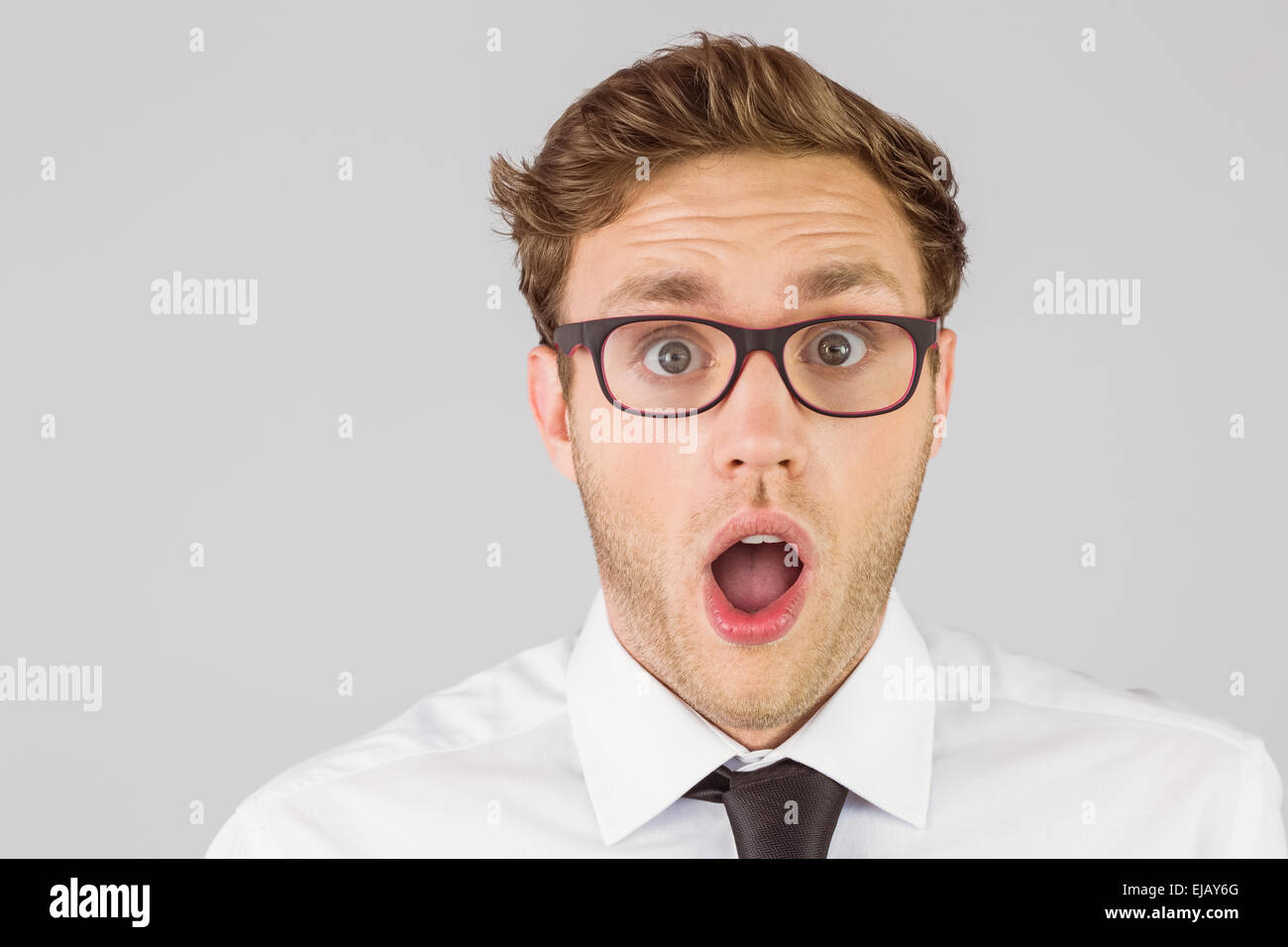 Geeky businessman looking at camera - Stock Image