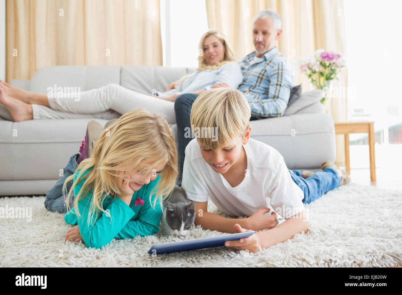 Happy family spending time together - Stock Image