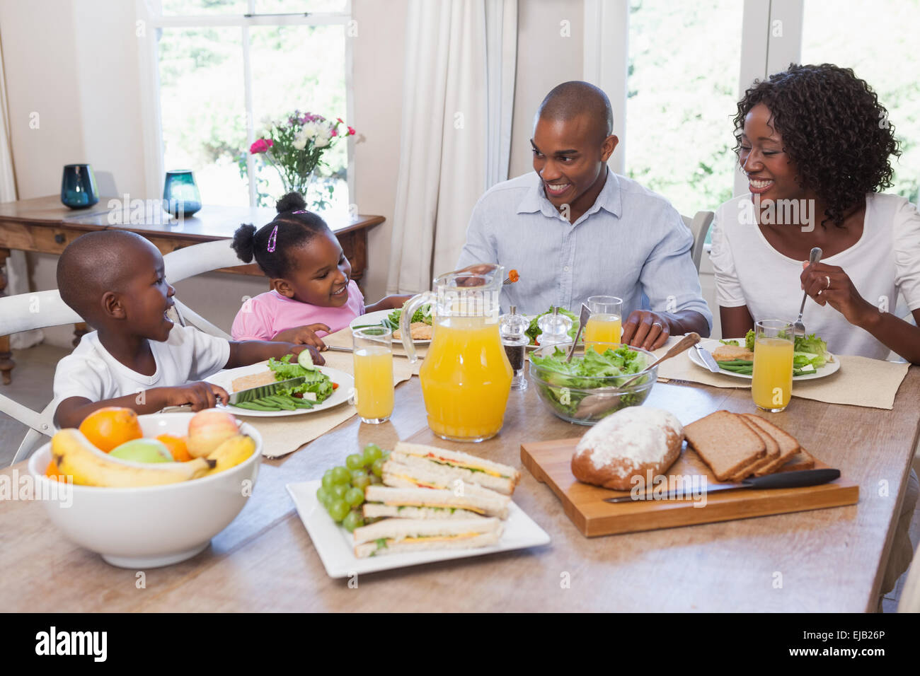 Happy family having lunch together - Stock Image