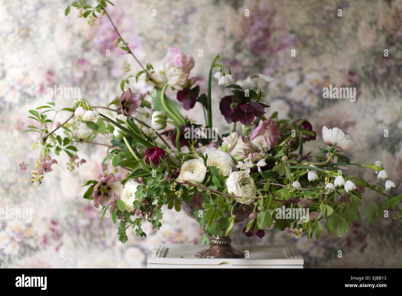 Spring bouquet of parrot tulips, ranunculus, anemones and Lucojum - Stock Image