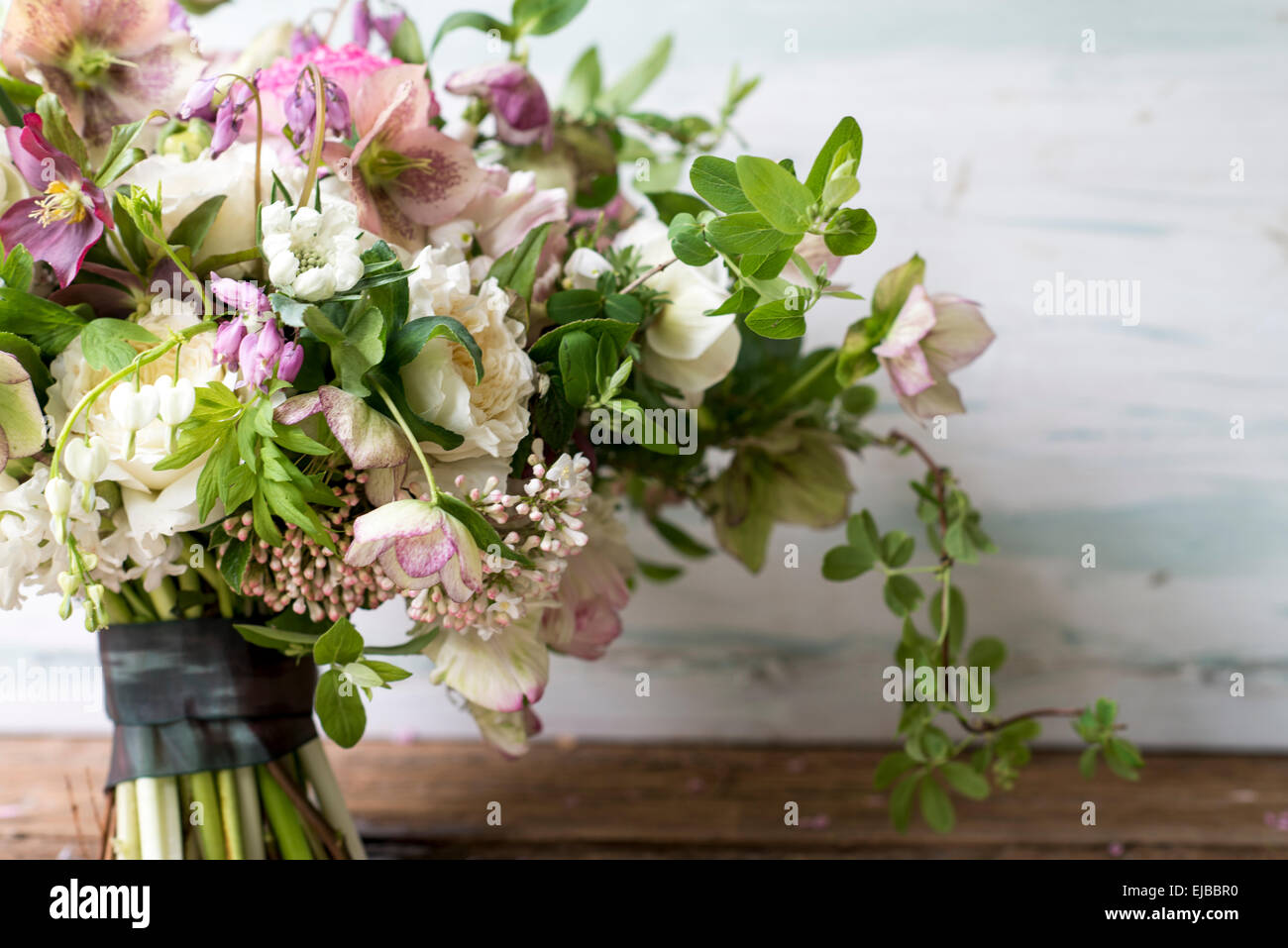 Abundant floral bouquet of spring blooming flowers including stock abundant floral bouquet of spring blooming flowers including ranunculus hellebore parrot tulip tulipa and white bleeding heart izmirmasajfo