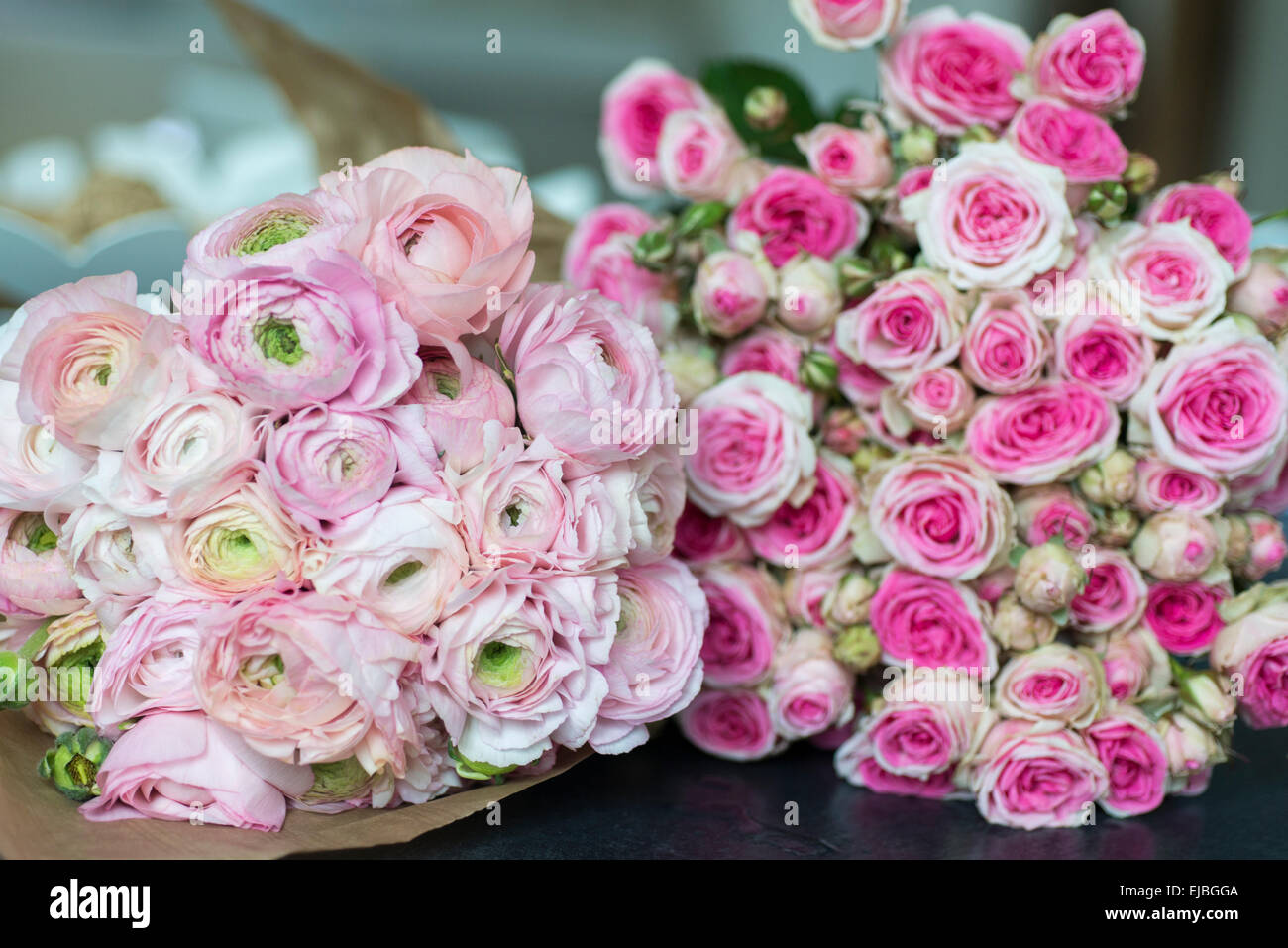 Bouquet of pink ranunculus and Mimi Eden spray roses in Paris apartment