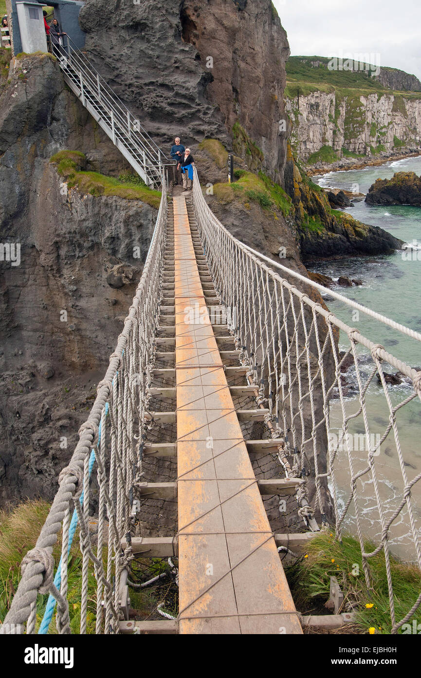 Visitors prepare to cross the  Carrick-a-Rede Rope Bridge in County Antrim, Northern Ireland - Stock Image