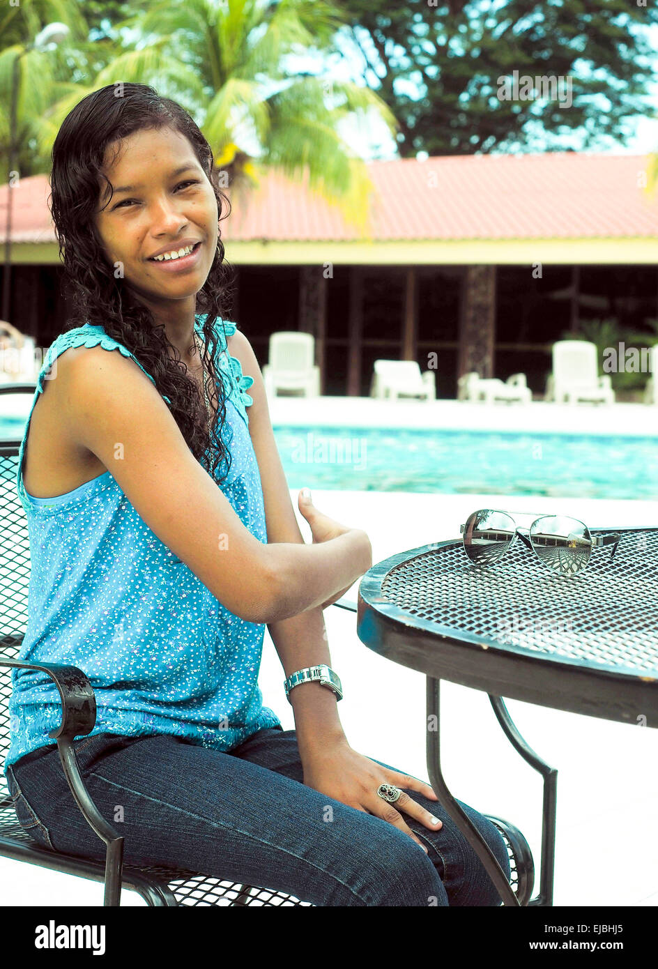 pretty Latina Creole woman from Big Corn Island Nicaragua on holiday at luxury hotel with swimming pool Managua Stock Photo