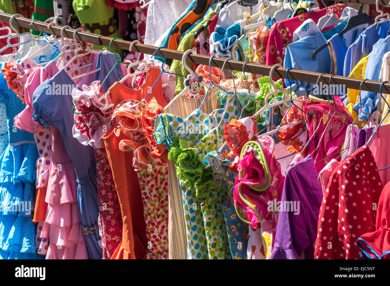 Traditional Flamenco dresses or Traje de Gitana. Rows of secondhand used dresses in the Thursday Flea market in - Stock Image