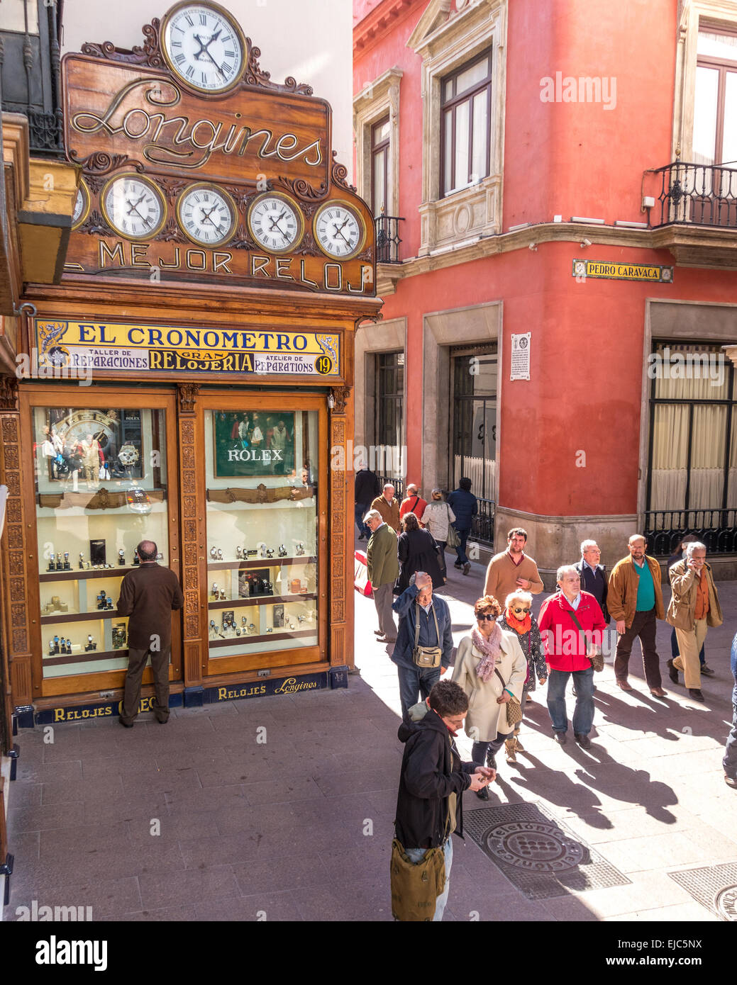 Calle Sierpes main shopping street in Seville Spain. Famous shop display facade of Longines watches, chronometers - Stock Image