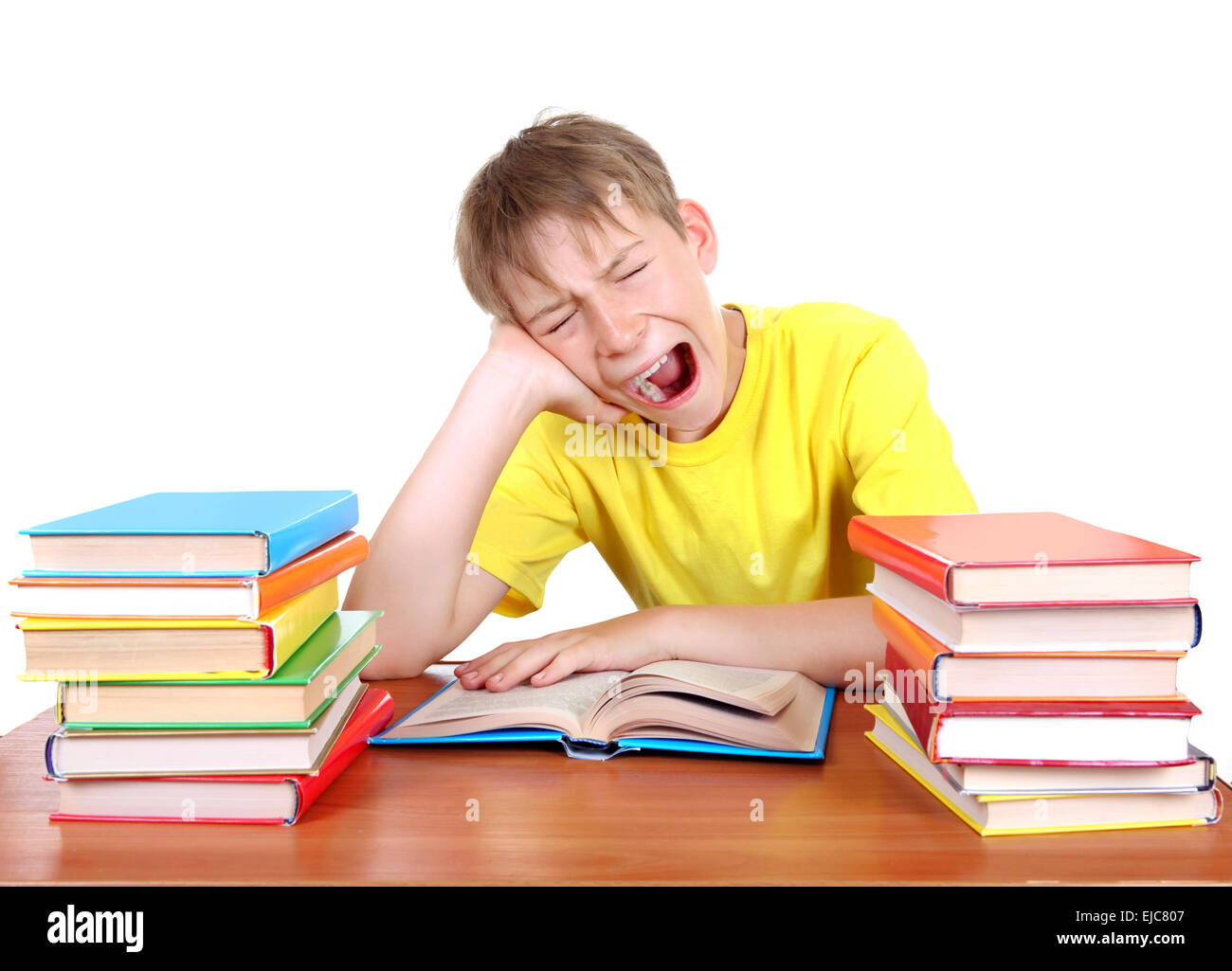 Tired Schoolboy yawning - Stock Image