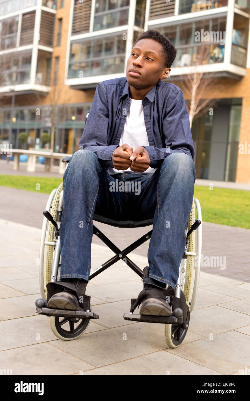 a wheelchair user feeling nervous or worried - Stock Image