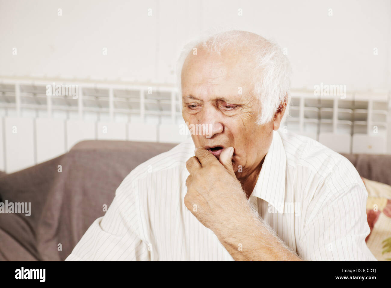 Old man in thoughts - Stock Image