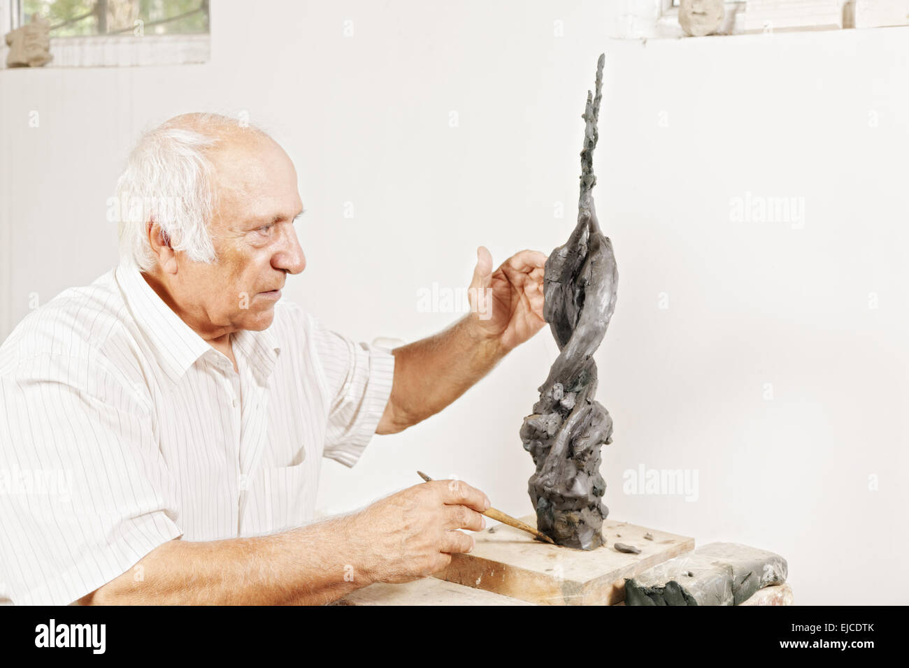Sculptor tells about his sculpture - Stock Image