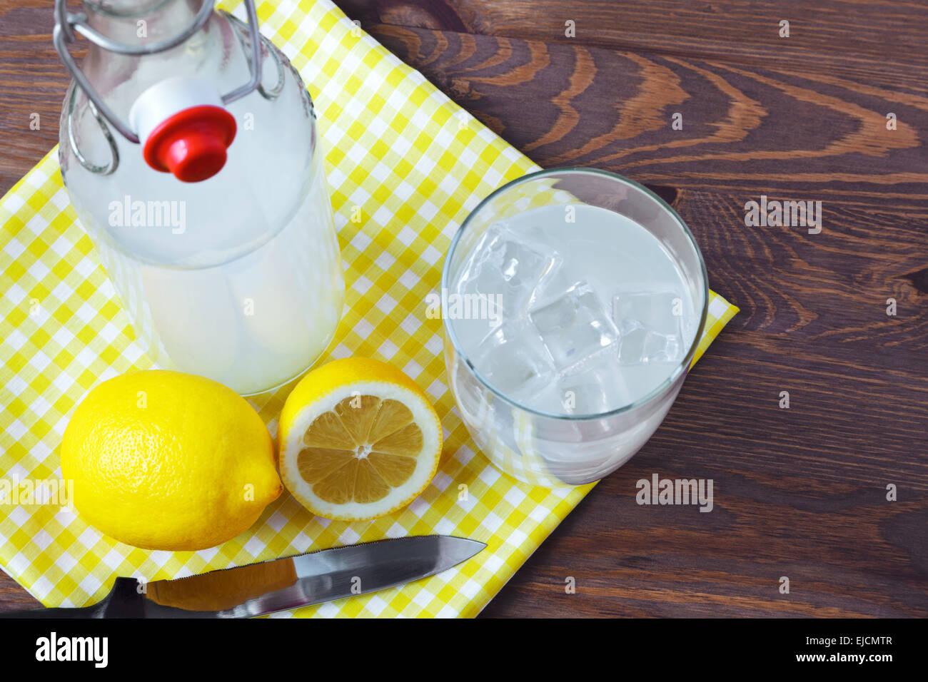 Still life photo of old fashioned or traditional homemade sour lemonade from an old style glass bottle. - Stock Image