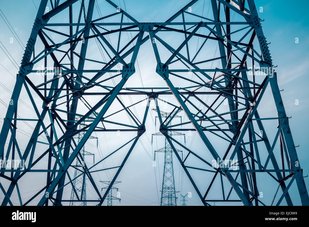 electricity transmission pylon silhouetted - Stock Image